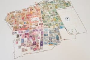 Wafa Hourani, The Stamp that Remains (Jerusalem), 2019, metal wires and stamps on canvas, 90 x 120 cm